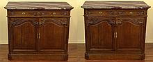 Matched Pair of 19th Century French Oak Marble Top Side Cabinets. Each with a Shaped Marble Top Above Two (2) Draws with Shell and Floral Carvings, Above Two (2) Carved Raised Panel Central Doors. Interior with Three (3) Slide out Storage Shelves.