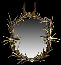 Anthony Redmile London 1970's. Large Antler Mirror Decorated with Silver and Hard-Stone Medallions. Very Good Condition. Measures 43 Inches Tall by 36-1/2 Inches Wide. We will not ship this item due to its size. We will happily recommend a list of