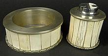 Anthony Redmile Studio 1970's Bone and Silvered Metal Ashtray and Lighter Set. Stamped on bottom AJH, (Anthony Hedgecock, who worked for Anthony Redmile) Typical Hairline age cracks in the Bone, a dent in the Lighter or in otherwise Good Condition.