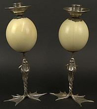Anthony Redmile, British (20th C) Interesting Pair of Candlesticks, C.1970's, Featuring Large Ostrich Eggs Mounted On Silvered Metal Stands in the Shape of Frogs With Hinged Bodies. Unsigned. Good Condition. Each Measures 17 Inches Tall. Shipping