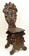 19th Century Carved Walnut Chair. Profusely Carved with Full Bodied Cherubs, Winged Females and Eagles. Very Good Condition. Measures 49 Inches Tall by 19 Inches Wide and 18 Inches Deep. We will not ship this item due to its size. We will happily