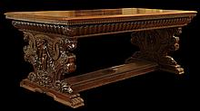 19th Century Renaissance Revival Walnut Library Table. Elaborate Overall Carving of Naked Figures as a Central Motif of the Pedestal legs, Each Joined with a Straight Stretcher, Below a Dentil Molded Frieze. Naturalistic Foliage with Lion and Rams