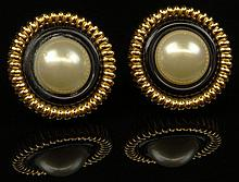 Pair Retro Chanel Faux Pearl Gold Tone Clip On Earrings. Signed on Back Chanel, Made In France, 2 3. Good Condition. Measures 1-3/8 Inches Diameter. Domestic Shipping $28.00