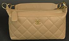 Chanel Quilted Leather Handbag with Goldtone Hardware. Signed Chanel Made in Italy. Minor Rubbing from Normal Use Otherwise Good Condition or Better. Measures 8 Inches Tall and 11-1/2 Inches Wide. Shipping $38.00
