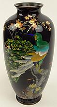Early to Mid 20th Century Japanese Cloisonné Vase. Decorated with a Finely Detailed and Colorful Peacock Motif. Signed with Stamp on Bottom. Very Good Condition. Measures 12-1/2 Inches Tall and 6-1/2 Inches Wide. Shipping $54.00