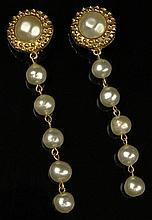 Pair Chanel Faux Pearl Gold Tone Dangle Earrings. Clip On Style. Signed on Back Chanel, Made In France 2,3. Very Good Condition. Measures 3-1/2 Inches Length. Domestic Shipping $28.00
