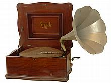 Rare Antique 19/20th C Regina Mahogany Double Comb Music Box/ Phonograph. Mahogany Serpentine Case on Pad Feet. Plays 20-3/4 Inch Disks. Wind-up Action. Serial # 1390111. In Working Order. Marked Inside of Lid as Well as on Comb Mounts. Includes 19
