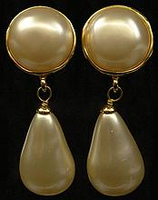 Pair Chanel Faux Pearl Gold Tone Drop Earrings. Clip On Style. Signed on Back Chanel, Made In France 2,9. Very Good Condition. Measures 2-1/2 Inches Length. Domestic Shipping $28.00