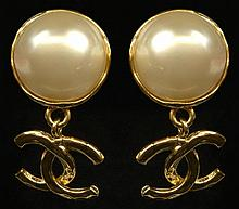 Pair Chanel Faux Pearl Gold Tone Logo Drop Earrings. Clip On Style. Signed on Back Chanel, Made In France 93,A. Very Good Condition. Measures 1-3/4 Inches Length. Domestic Shipping $28.00