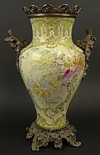 Early 20th Century German Royal Bonn Bronze Mounted Porcelain Vase with Painted Floral Decoration. Marked to Base. Minor Glaze Crazing, Drilled, Otherwise Good Condition. Vase Measures 16-1/2 Inches Tall and 10 Inches Wide, Overall Measures 20-1/2