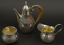 Three (3) Piece Antique Sterling Silver Petite Tea Service. Slanted Ribbed Motif. Signed with Stags Head, 925, cartouche on Bottom. Both the Creamer and Tea Pot have dings/dents. Measurements: Tea Pot 7 Inches Tall, Creamer, 3-1/2 Inches Tall, 2-1/2