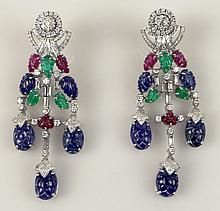 Exceptional Pair of Lady's 48.0 Carat Carved Sapphire, Emerald and Ruby, 4.30 Carat Round Brilliant Cut and Emerald Cut Diamond and 18 Karat White Gold Tutti-Frutti Chandelier Earrings. Diamonds E-F Color, VS1-VS2 Clarity. Unsigned. Very Good