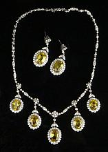 Spectacular and Important Edwardian Design 42.25 Carat Seven (7) Large Oval Cut Natural Yellow Sapphire and 10.50 Carat Round Brilliant Cut and Marquise Cut Diamond and 18 Karat White Gold Necklace and Earring Suite. Sapphires with Vivid Yellow