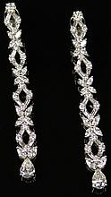 Stunning Pair of 9.00 Carat Pear, Round, Marquise and Baguette Shape Diamond Lady's Drop Earrings. Diamonds E-F-G Color, VS1-VS2 Clarity. Unsigned. Very Good Condition. The Drops Measure Approximately 2-3/4 Inches. Weighs 8.65 Pennyweights. Shipping