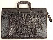 Vintage Brown Crocodile Portfolio Briefcase. Unsigned Surface Wear to Handles and Corners. Interior Ink Marks and Soiling Otherwise Good Condition. Measures 12 Inches Tall and 17-3/8 Inches Wide. Shipping $44.00