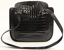 Lady's Vintage Italian Cesare Piccini Black Crocodile Shoulder Bag with Gold Tone Hardware. Signed. Minor Surface Wear from Normal Use Otherwise Good Condition or Better. Measures 11 Inches Tall and 11-1/2 Inches Wide. Shipping $48.00