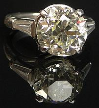 4.08 Carat Round European Cut Diamond Engagement Ring Set in Platinum and 14 Karat White Gold Mounting, Size 6. Set with Center Stone of K-L Color and VS1 Clarity. Signed FM Plat 950 and 14K. Very Good Condition. Weighs 4.30 Pennyweights. Shipping