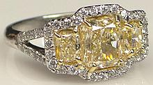 EGL Certified 2.05 Carat Cut Corner Rectangular Modified Brilliant Fancy Intense Yellow Diamond Engagement Ring Flanked by Two (2) Side Cut Corner Rectangular Modified Brilliant Fancy Intense Yellow Diamonds Set in Platinum and Accented with Forty