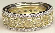 EGL Certified 8.62 Carat Cut Corner Rectangular Modified Brilliant Fancy Yellow to Fancy Intense Yellow Nineteen (19) Diamond Eternity Ring Set in Platinum and 18 Karat White Gold and Accented with Eighty Three (83) Round Brilliant Cut Diamonds