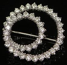 Lady's Vintage 3.43 Carat Total Weight Round Brilliant Cut Diamond and 18 Karat White Gold Swirl Brooch. Diamonds G Color, VS1 Clarity. Unsigned. Good to Very Good Condition Measures 1 Inch Diameter. Approximate Weight: 2.30 Pennyweights. Shipping