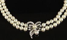 Lady's Vintage Double Strand White Pearl Necklace Comprising One Strand of Seventy-Eight (78) 5.25-5.5mm Pearls and a Stand of Eighty-Two (82) 3-3.5mm Pearls and with 14 Karat White Gold Diamond and Pearl Clasp. Unsigned. Good Condition or Better.