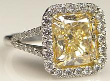 EGL Certified 5.01 Carat Cut Corner Rectangular Modified Brilliant Fancy to Fancy Intense Yellow Diamond Engagement Ring Set in Platinum and Accented with Forty Four (44) Round Brilliant Cut Diamonds Weighing .89 Carat. Signed PT 900. Center Diamond
