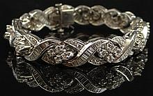 8.40 Carat Round Brilliant Cut and Baguette Diamond and Platinum Bracelet. Round and Baguette Cut Diamonds of VS1-VS2 Clarity with a Few of SI-1 Clarity and F-G Color, Mounted in Platinum with Safety Lock. Unsigned. Good to Very Good Condition.