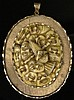 Mid 20th Century Japanese 14 Karat Yellow Gold and Ivory Pendant with Finely Carved Mask Detail. Unsigned. Surface Wear from Normal Use Otherwise Good Condition. Measures 3-1/8 Inches Tall and 2-3/8 Inches Wide. This item will only be shipped