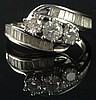 Lady's Round Brilliant Cut Three (3) Diamond Ring Set with Twenty-Eight (28) Channel Set Baguette Cut Diamonds Mounted in a 14 Karat White Gold Setting, Size 9-1/2. Total Weight of Diamonds Approximately 1.00 Carats of F-G Color, VS1-VS2 Clarity.
