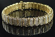 Lady's 10 Karat Yellow Gold and 330 Diamond Bracelet. Signed 10K, 5.00 and Makers Mark. Good Condition or Better. Measures 7 Inches Long. Weighs 11.90 Pennyweights. Shipping $26.00