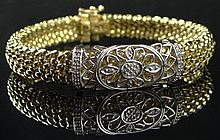14 Karat Yellow and White Gold and Eighteen (18) Diamond Lady's Mesh Bracelet with Safety Lock. Signed 14K and Makers Mark. Very Good Condition. Measures 7-3/8 Inches Long and about 1/2 Inch Wide. Weighs 11.60 Pennyweights. Shipping $26.00