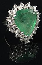 Lady's 18 Karat White Gold, Teardrop Emerald and Diamond Ring. Set with Large Pear Shape Emerald Center Stone and Thirty One (31) Round Brilliant Cut Diamonds. Unsigned. Good to Very Good Condition. Ring Size 6, Weighs 4.75 Pennyweights. Shipping