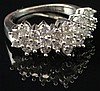 Modern Lady's Diamond Band Style Ring Set with Twenty-Seven (27) Round Brillant Cut Diamonds Mounted in a 10 Karat White Gold Setting, Size 7-1/4. Total Weight of Diamonds Approximately 1.50 Carats of F-G Color, VS1-VS2 Clarity. Signed 10K. Good to