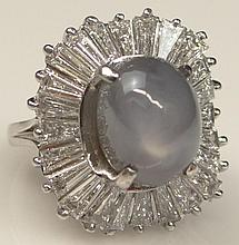 Gem Quality Lady's 8.50 Carat Star Sapphire, Approx. 2.0 Carat Tapered Baguette Diamond and Platinum Ballerina Ring. Diamonds E-F Color VVS-VS Clarity. Signed 900 Plat. Ring Size 3-1/2. Very Good Condition. Approx. Weight: 5.95 pennyweights. Shipping