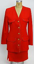 From a Palm Beach Socialite, A Retro/Vintage Emanuel Ungaro Red Wool Jacket and Skirt Suit. Labeled: Emanuel Ungaro Paris Parallele Made In Italy. Jacket Size 10. Skirt Size 8. Lined. Good Condition. Skirt Length 22 Inches. Shipping $65.00