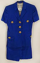 From a Palm Beach Socialite, an Escada Blue Cotton Shorts and Jacket Suit. Floral Gold Tone Buttons. Labeled: Escada By Margaretha Ley Made in West Germany. Jacket Size 38 (6 US). Shorts Size 40 (8 US) Good Condition. Shorts Measure 19 Inches Length.