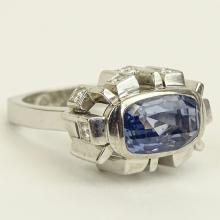Approx. 8.65 Carat Natural Unheated Ceylon Sapphire and 18 Karat White Gold Ring accented with .60 Carat Round Cut Diamonds. Diamonds E-F color, VS clarity. Signed 18K. Very good condition. Ring size 6. Approx. weight: 10.20 pennyweights. Shipping $26.00