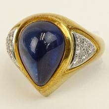 Tenhagen Laboratory Certified 7.53 Carat Cabochon Ceylon Sapphire and 18 Karat Yellow Gold Ring accented with .36 Carat Round Cut Diamonds set in Platinum. Diamonds H color, VVS clarity. Signed 750 and PT950. Very good condition. Ring size 6. Appraisal Number 1056911 dated 11/22/11 to accompany this Lot. Approx. weight:7.55 pennyweights. Shipping $30.00