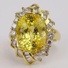 Approx. 14.07 Carat Oval Cut Sapphire, 1.05 Carat Diamond and 18 Karat Yellow Gold Ring. Diamonds G-H color, VS clarity. Signed 18K 750. Very good condition. Ring size 6. Approx. weight: 7.05 pennyweights. Shipping $26.00