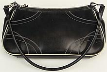 Prada Black Leather Lady's Handbag with White Stitching. Has Original Prada Storage Bag. Signed Prada, Milano. Made in Italy. Good to Very Good Condition, Shows Little Wear if Any. Measures almost 7 Inches Tall by 12 Inches Wide Not Counting Strap.