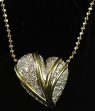 Lady's 2.5 Carat Pave Set Round Brilliant Cut Diamond and 18 Karat Yellow Gold Heart Pendant with 14 Karat Yellow Gold Chain. Diamonds G-H Color, VS1-VS2 Clarity. Signed. Good Condition or Better. Pendant Measures 1-1/8 Inches Long and 1 Inch Wide,