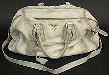 Prada White Deerskin Leather Lady's Handbag. Has Original Prada Storage Bag. Signed Prada, Milano. Made in Italy. Wear and some Staining or else Good Condition. Measures 10 Inches Tall by 18-1/2 Inches Wide Not Counting Strap. Shipping $30.00