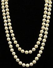 Vintage Single Strand 8mm-8.5mm Opera Length Pearl Necklace. Unsigned. Good Condition. Measures about 30 Inches Long and 5mm Diameter. Shipping $26.00