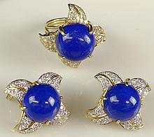 Three (3) Piece Approx. 2.0 Carat Round Brilliant Cut Diamond, Lapis Lazuli and 18 Karat Yellow Gold Flower Ring and Ear Clip Suite. Diamonds G-H Color, VS2-SI Clarity. Lapis in Ring Measures Approx. 13mm Wide. Signed 750. Good Condition or Better.