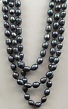 113 Count Strand of Charcoal Gray to Black Rope Length Baroque Pearls Measuring Approximately 72 Inches Long and 8mm to 10mm Diameter. Very Good Overall Condition. Shipping $32.00