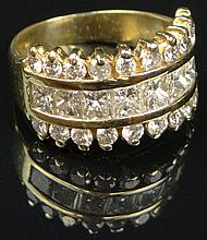 Contemporary 14 Karat Yellow Gold and Diamond Lady's Ring. Size 6. Signed 14K. Set Throughout with Twenty-Eight (28) Square Cut and Round Brilliant Cut Diamonds Totaling Approximately 2.00 Carats. Weighs 5.00 Pennyweights. Very Good Condition.