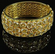 Lady's 85 Carat Pale Yellow-Green-Blue Quartz, 4.50 Carat Tsavarite and Vermeil Hinged Cuff Bracelet. Unsigned. Good Condition or Better. Interior Diameter 2-3/8 Inches Diameter. Approx. Weight 50.30 Pennyweights. Shipping $34.00