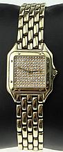 Man's Vintage 14 Karat Yellow Gold Cartier style Tank Watch with Link Bracelet, Micro Pave Diamond Face and Quartz Movement. Unsigned. Tested for 14 Karat. Surface Wear from Normal Use, Appears to be in Good Running Condition. Watch Measures 1-3/8