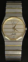 Man's Concord Mariner SG 18 Karat Yellow Gold and Stainless Steel Quartz Watch. Signed. Surface Wear Consistent with Normal Use. Not Running (likely needs a new battery), Otherwise Good Condition. Case Measures 1-1/4 Inches Wide, Bracelet Measures