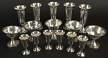 Set of 16 Sterling Silver Drink ware. This Lot includes: 5 Wine Cups, 5-1/5 Inches Tall, 5 Champagne Cups, 3-1/4 Inches; 6 Kiddush or cordial cups, 3-1/4 Inches. A;; Pieces are signed STERLING. Several with dents and dings. Total Weight 15.70 Troy